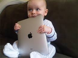 Baby chewing on ipad