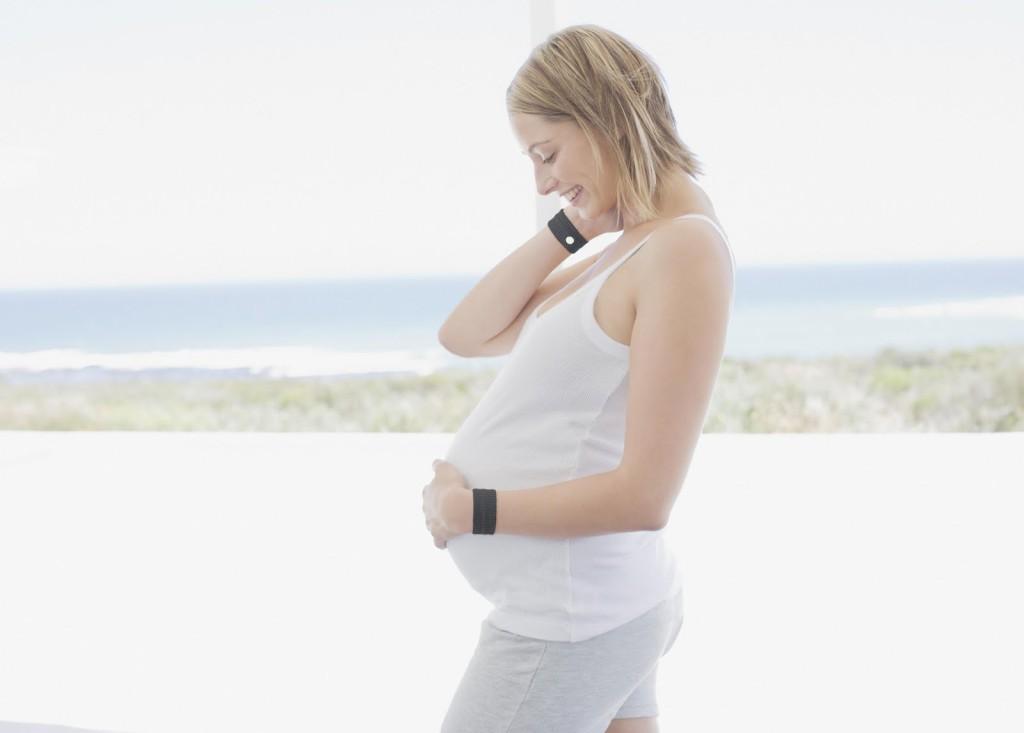 Pregnant woman wearing accupresure wrist bands